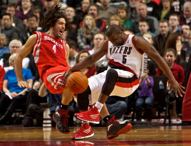 Feb 8, 2012; Portland, OR, USA; Houston Rockets power forward Luis Scola (4) and Portland Trail Blazers point guard Raymond Felton (5) collide in the third quarter at the Rose Garden. Mandatory Credit: Craig Mitchelldyer-US PRESSWIRE