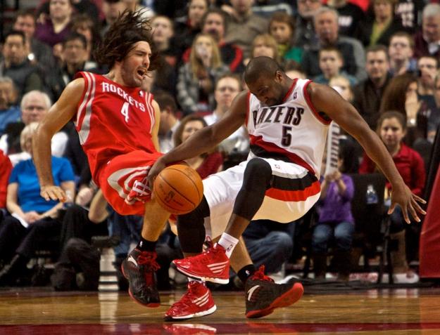 Feb 8, 2012; Portland, OR, USA; Houston Rockets power forward Luis Scola (4) and Portland Trail Blazers point guard Raymond Felton (5) collide in the third quarter at the Rose Garden. Mandatory Credit: Craig Mitchelldyer-US PRESSWIRE