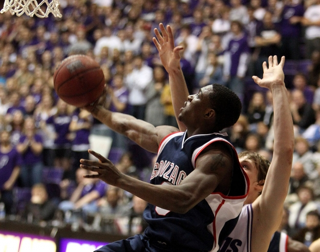 Feb 5, 2009; Portland, OR, USA; Gonzaga guard Demetri Goodson (3) shoots past Portland forward Robin Smeulders (12) in the first half at the Chiles Center in Portland, OR. Mandatory Credit: Craig Mitchelldyer-US PRESSWIRE