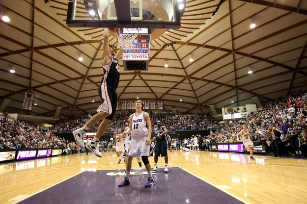 Feb 5, 2009; Portland, OR, USA; Gonzaga forward Josh Heytvelt (42) dunks over Portland forward Robin Smeulders (12) in the second half at the Chiles Center in Portland, OR. Gonzaga won 93-78. Mandatory Credit: Craig Mitchelldyer-US PRESSWIRE